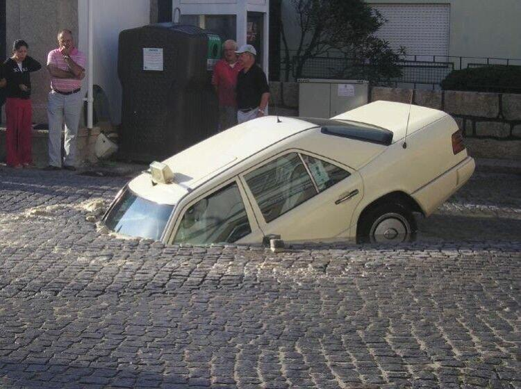 Funny picture of Car stuck in ground