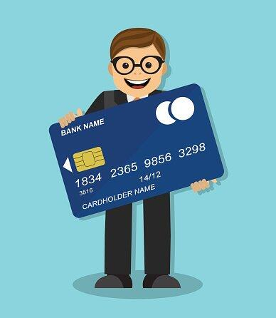 businessman-holding-a-credit-card.